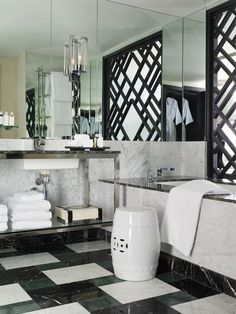 Viceroy Miami, Miami, Fla.    The hotel's bathrooms are a spare-no-expense spa-like experience with Sferra linens, Neil George toiletries and Kelly Wearstler's glamorous design touches. She combined sleek modern fixtures with black, green and white marble, wall-to-wall mirrors and Asian-inspired screens. Image courtesy of