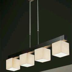 estas lamparas colgantes modernas que esten bajas sobre la barra del desayunador en