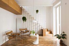 Este apartamento expandiu para cima! Os moradores precisavam de mais espaço para seus dois filhos e decidiram adquirir o apartamento de cima. Les Ateliers