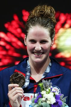 Gold medal winner Missy Franklin of the USA celebrates on the podium after the Swimming Women's 200m Freestyle Final on day twelve of the 15th FINA World Championships at Palau Sant Jordi on July 31, 2013 in Barcelona, Spain.