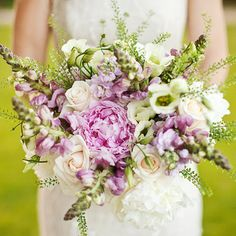 """ 3/10 Bouquet created by Blush Floral Design  Larger, less structured bouquets using wild flowers and foliage are all the rage thanks to the popularity of vintage-inspired, English country weddings. This pretty bouquet uses snap dragons, stocks, peonies, roses and on-trend green bell, used by both Lily Allen and Kate Moss in their wedding flowers."""