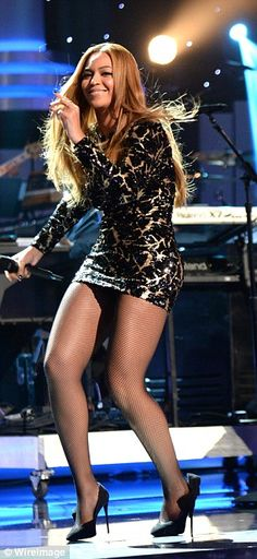 Rocking good time: The singer stood tall in stilettos as she sported a black and gold dress as the stalked both onstage and through the audience