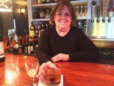 Marilyn Gorneau tends her bar at Little Village Bistro in Wiscasset. SUZI THAYER/Boothbay Register