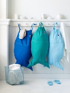 Sea fun. Beach house + laundry ready. Pisces Laundry Bag - Light Blue | The Organizing Store #designideas #fish #laundrybag