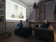 A television can be a troublesome design element, so in this case the designers went with a projection system. The screen easily rolls up and out of sight, then pulls down for movie night with a few friends.