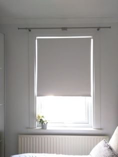 Blackout roller blind in polar white fitted to bedroom window in Fulham    Modern blinds   Bedroom blinds   Blackout blinds   Made to measure   Made in UK
