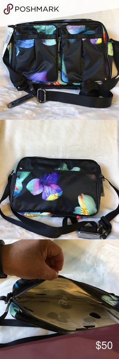 NWT Lesportsac signature Kate Crossbody Bag NWT Lesportsac Signature Kate Winter Floral Patent bag, strap is adjustable and can also be worn as a shoulder bag, has plenty of pockets inside and out, great for organizers, smoke free LeSportsac Bags Crossbody Bags