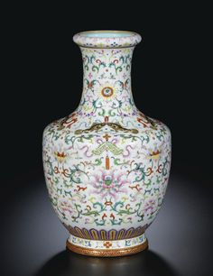 A FAMILLE-ROSE 'TWIN FISH AND CHIME' VASE QING DYNASTY, 18TH CENTURY Ht 31 cm