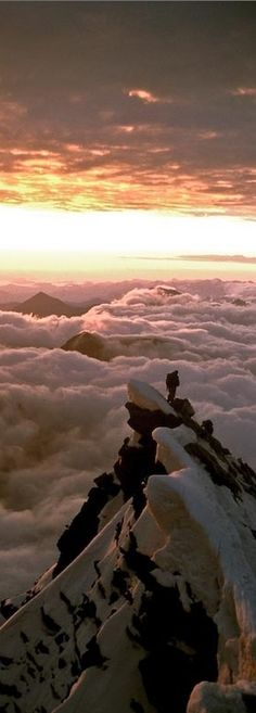 Above the clouds on Grossglockner in the Austrian Alps • orig. source not found