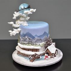 Winter Themed Fondant Scenery Cake tutorial (clickable link in bio) . Christmas Cake Designs, Christmas Cake Decorations, Holiday Cakes, Christmas Treats, Christmas Baking, Christmas Cakes, Pretty Cakes, Beautiful Cakes, Amazing Cakes