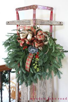 Vintage sled with fresh greenery swag as Christmas decor | Meadow Lake Road