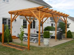 The Ultimate Honey Do: Pergola and Furnishings, Pergola with dining and entertaining space and custom touches built by my husband., View of ...