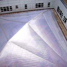 Walsgrave Hospital Courtyard Roof, designed by Peter Dann's sister company Xanadome. The structure uses significantly less steel and embodied energy than any comparable structure, and the canopy was erected in one day.