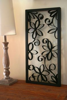 Wall Art made from toilet paper rolls, a picture frame and some black paint by MissMolly28