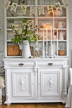Vintage White china cabinet with botanical prints and white pottery