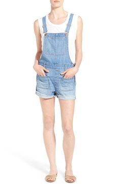 These lightweight denim short overalls with metallic side zips feature just enough fading to make them look like they've been the fave spring piece for years.