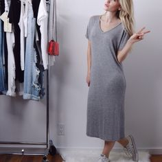 """Gray Midi Tee Dress Loose fit gray midi dress that is effortlessly chic. Wear with sneakers or dress up with lace up sandals. Super comfy and easy. One of my fav pieces. 95% rayon, 5% spandex, silky soft lightweight material with great stretch. Length is 44"""" (taken from the small). Sizes S, M, L available. Please comment size needed and I will make you a listing. Boutique Dresses Midi"""