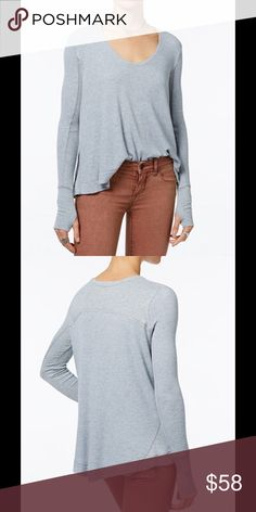 """Free People """"Malibu"""" High-Low Thermal Top Free People """"Malibu"""" High-Low Thermal Top - A classic staple gets a stylish upgrade in this thermal top. Features trendy thumb holes and a drapey fit, for the ultimate cool-girl vibe. - rayon/spandex, trim: rayon/spandex - scoop neckline - Pullover - long sleeves with thumb holes - ribbed contrast at sleeves, sides and back - high-low hem with side vents - hits below hip Free People Tops"""