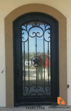http://porteusa.com/ Wrought Iron Single Door - Texas Star by Porte, Color Faux Copper, Flemish Glass and Madison Hardware