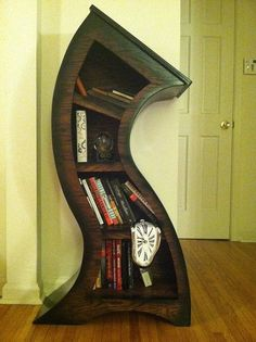 Go home, bookcase. You're drunk.    This rubbery-looking bookcase is made from firm oak plywood. It's one of many wonderful, oddly-shaped bookcases made by Scott Blackwell. This Dali-esque piece, Blackwell would like for you to know, comes with a free melting clock.
