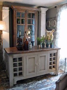 Old columns flanking cabinet...good idea for dining room (back wall)