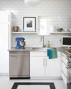 Stainless steel countertops and white subway tile in a modern kitchen