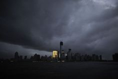 The skyline of lower Manhattan, as seen from Exchange Place, is mostly in darkness except for the Goldman Sachs building after a preventive power outage caused by giant storm Sandy, in New York October 30, 2012. By Eduardo Munoz.