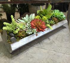 Artificial summer succulent creation in a galvanized chicken feeder!