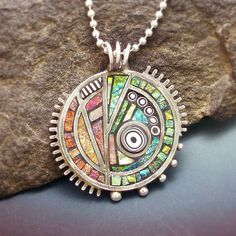 Poly clay and PMC pendant.  Love the steam punk feel but with bright, summery colors instead of the usual foggy smoggy shaded colors.