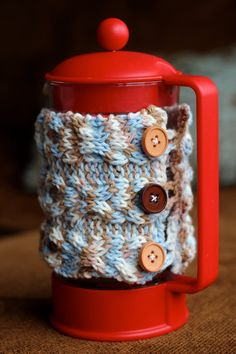 French Press Cozy.  I know this is knitted but I'll crochet mine.
