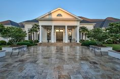 9279 White Blossom - 4 Beds / 5 Bath - This Traditional European Style Plantation Estate sits on one of the highest points in NE Tallahassee. Surrounded by Lush Waterfalls and landscaping that makes you relax and enjoy the abundance of nature. As you enter the front door you are greeted by a grand entry way and views through the 14'-25'ceilings,Custom Moldings and Mill work in the Formal Living area, to the Pool and Fountain located just outside.  #floridamansion #tallahassee