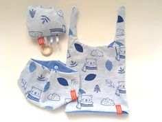 Original sSCAPESs art & handmade This gift set consisting of reversible - two sided beanie, bandana bib and rattle cloud toy is perfect for your favorite little one's fashionable needs and playtime.  Each piece is One Of A Kind (OOAK) - unique and original sSCAPESs design manufactured in Vienna, Austria/European Union. All sSCAPESs handmade items are made of high quality eco-certified baby-friendly cotton.