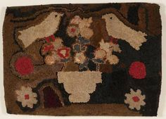 Hooked Rug with Two Birds  The two birds perched on a stylized pot of flowers are in stark contrast to the dark background exagerating the naive character of this rug.  ~ ITEM DETAILS ~ Dimensions: 28 x 39 inches  Date / Circa: Circa 1900  Maker / Origin: American  Medium: Mixed fabric rags on burlap. Mounted for display. ~♥~