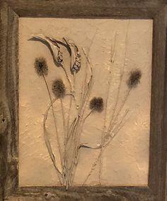 Botanical plaster artwork with frame approximately 15x19.