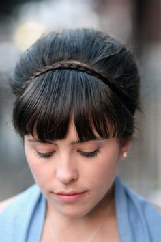 Love this hairstyle. Makes me want to keep my bangs.
