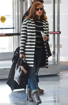 These boots are made for walking: Eva Mendes departing New York's JFK airport on Friday...
