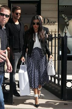 10 Surprisingly Chic Kardashian Outfits From 2014 #refinery29 http://www.refinery29.com/2014/12/79788/kardashian-outfits#slide1 Being a mom doesn't stop Kourtney from dressing up, and this year she continued to perfect her classics-with-a-twist vibe. While in Paris last May, she paired a ladylike, polka-dot midi-skirt with a (subtly) sexy crop top and a tough-girl moto jacket. BLQ Basiq Crop Top in White, $64.99, available at Boutique to You; ASOS Spot Pleat Midi Skirt, $32.22, available ...