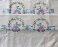 Two White Pillowcases with Pink and Blue Embroidered by Redcurlzs