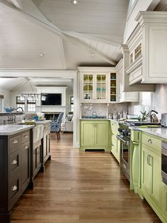 Green, white and black cabinetry mix in this open kitchen  - Trend Alert - Mixed Cabinet Finishes in the Kitchen