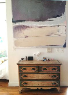 love this neutral LARGE painting over the small, sort of graphic dresser.