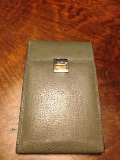 Leather wallet with a silver and gold closure