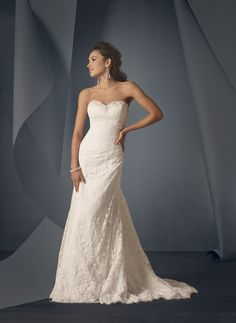 Draped lace Style 2208 wedding dress, $750, Alfred Angelo