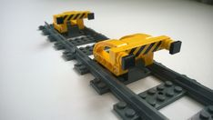 End line buffers. In Sweden these are typically yellow steel beam structures. I figured yellow Lego technic beams would be the nearest equivalent, and put together two concepts this morning. Both designs are simple, yet strong due to the use of technic parts.