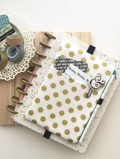 Pocket Planner Pouch - Gold polka dots   This pocket planner pouch is made from a print fabric. It features a front slip pocket, FOE pen holder and FOE (fold over elastic) back planner band. The inside zipper pouch space is roomy, and very ideal to hold washi tapes, page flags, stickers or anything else you can think of. The Simbiosis Pocket Planner Pouch, is made from QUALITY quilting cotton fabrics, not cheap/thin grocery bag material. The Pocket Planner Pouch has reinforced stitches, ...