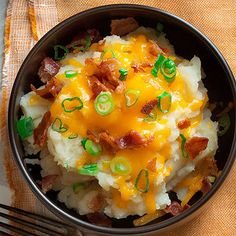 Talk about super bowls! Think of these creamy crowd-pleasers as deconstructed, fully-loaded baked potatoes. Set out toppings so everyone can build their own snack. Other stellar topping options include steamed broccoli, chives, sour cream, and hot sauce, of course.