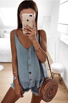 light blue button down tank top, jean shorts, and leather cross body. Cute and casual spring or summer outfit.