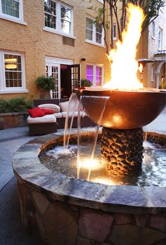 Would love to bring a fire and water feature like this together for a pool. Maybe 3 columns on one end of pool with fire and water pots?