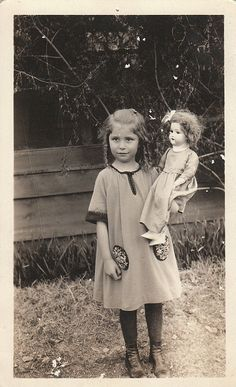 old photo of little girl with her doll