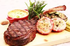 Prime's Tomahawk USDA Prime Angus Bone in Ribeye, Grilled Asparagus, Tomato-Parmesan Gratin, Potato Mousseline and House Steak Sauce  Only at 22 Prime. Call (02)719.6822 for a culinary treat, inquiries or reservations.  #DiscoverySuites #22 Prime #food
