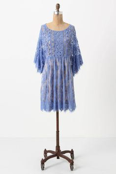 Love this shade of blue - that of my favorite 'hortensia' (hydrangea) flowers in Paris.  I'd pair this lacy dress with some tougher pieces in leather to tone down some of the sweetness.
